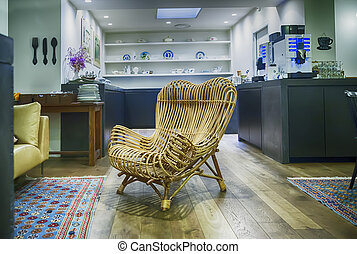 chair by hotel kitchen - wooden lounge chair by hotel...