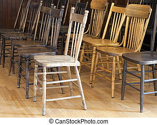 Antique Wooden Chairs - Antique wooden chairs in a...