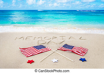 Memorial day background on the sandy beach near ocean