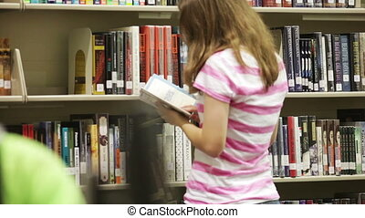 Students in school library - A group of students working...