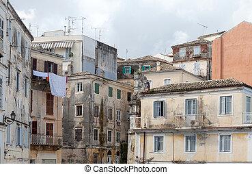 Crumbling buildings in Corfu - Dilapidated buildings in the...