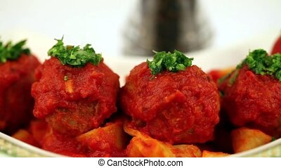 Meatballs Parmesan - Stock footage of grating parmesan above...