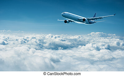 Airplane flies above clouds - air travel - Passenger plane...