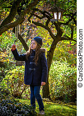Young girl in mistery garden - Young girl in mistery autumn...