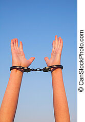 Handcuffed woman hands