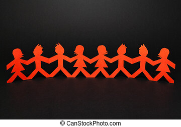 Team of paper doll people holding hands - Group of paper...