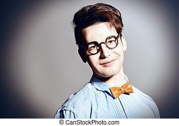 smart fun - Portrait of an extravagant young man in bow-tie...