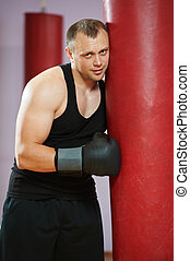 boxer man after boxing training with heavy bag