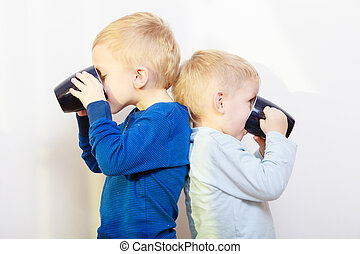 Happy childhood. Two brothers little boys drinking tea -...