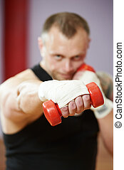 boxer man at boxing training with dumbbells