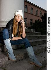 Talking over the phone - Glamour brunette model sitting on...