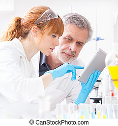 Health care professionals in lab - Attractive young female...