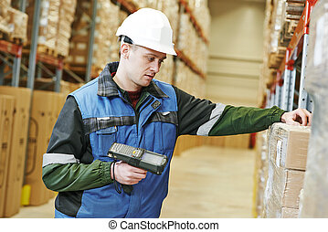 warehouse worker with scanner - worker man in uniform...