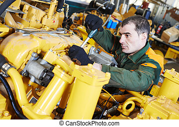 industrial assembler worker - industrial worker during heavy...