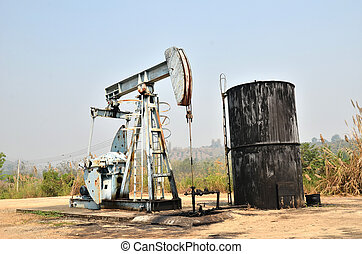 pumpjack pumping crude oil from oil well - old pumpjack...