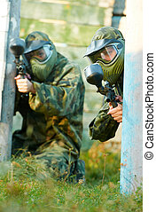 two paintball players