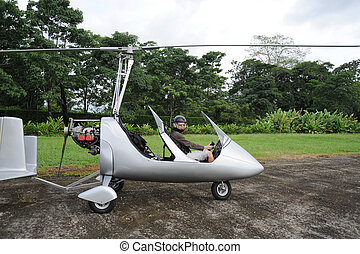 Woman pilot sitting in the autogyro
