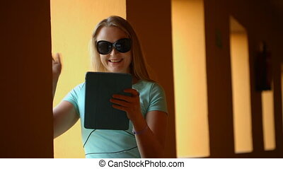 Video chat using touchpad - Young woman having a video chat...