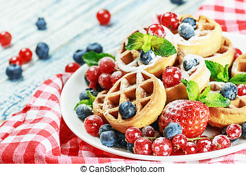 Waffles with fresh berries on the table - Waffles with fresh...