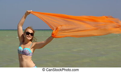 Woman with pareo waving in the wind