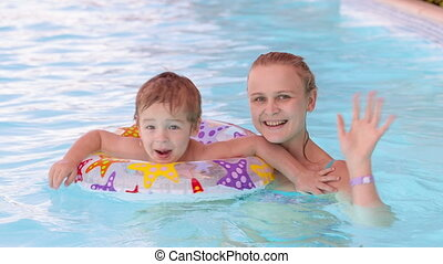 Mother and son swimming in the pool - Mother and son in the...