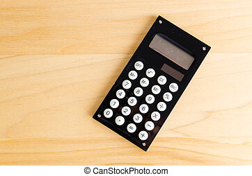 Calculator on wood table