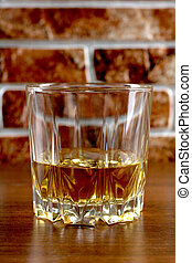Whiskey on brick - Luxury old whiskey glass on brick wall...