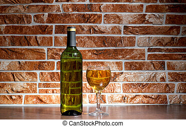 Wine of bottle on brick - Wine bottle and glass on brick...