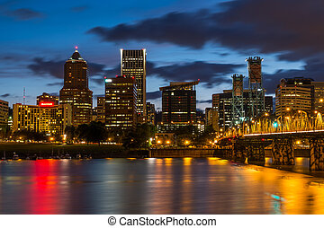 Nighttime Portland Skyline - Colorful lights reflecting off...