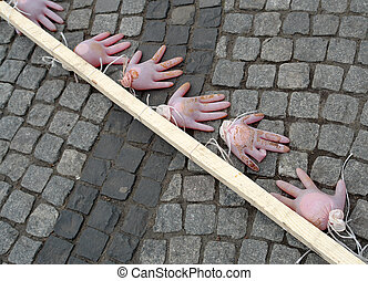 Metaphorical hands on the pavement as a symbol of the...
