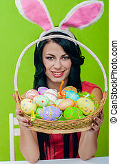 girl with a basket of Easter eggs - Beautiful girl with a...