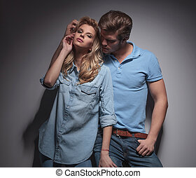 man playing with his girlfriend in a sexy pose