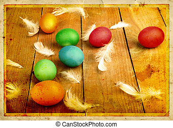 Grunge old carved postcard with eggs to celebrate Easter on...
