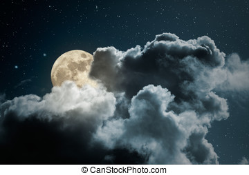 Full moon night - Full moon behind the clouds on a starry...