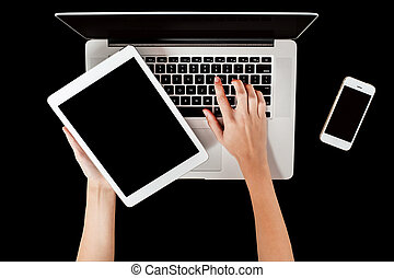Brand new laptop, tablet and smartphone - Woman hand holding...