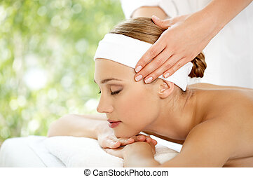 Spa and Wellness - Young beautiful and relaxed lady taking...