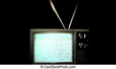 Static TV - Older television playing static, zoom in