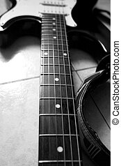 Guitar - Black and white close up of neck of guitar