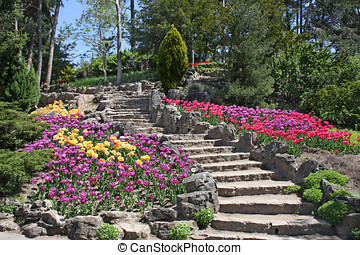 Stone Garden Stairs - Sweeping stone stairway amid...