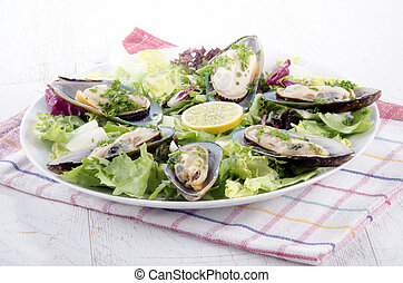 green lipped mussels from new zealand with salad and lemon...