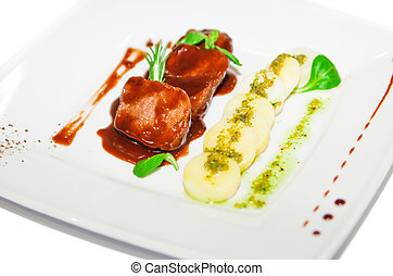 Meat with potatoes in red sauce on plate restaurant menu