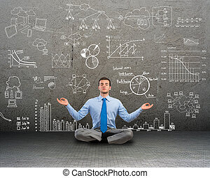 business man meditating on floor - image of a business man...