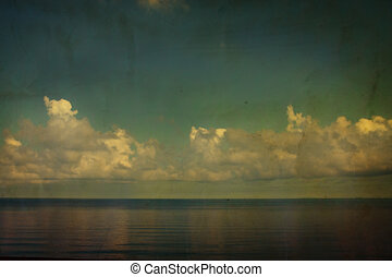 Grunge white clouds and clear sea in vintage style - Grunge...