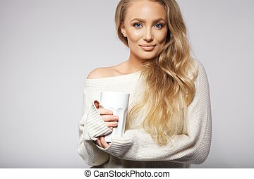 Attractive young with a hot cup of coffee - Portrait of...