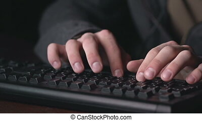 Suspicious Activities - Tilt from male fingers typing on...