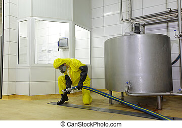 technician working with large hose - technician with large...