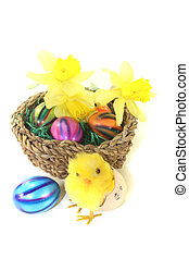 Easter Basket with chick, daffodils and colorful eggs on a...