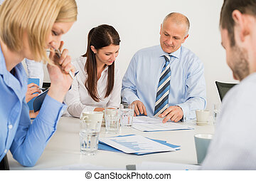 Business Team Discussing Document - Business team discussing...