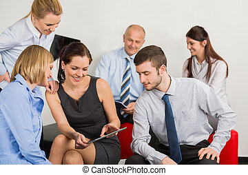 Business Team With Digital Tablet - Business team with...