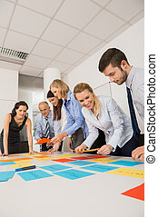 Business Colleagues Brainstorming With Labels - Business...